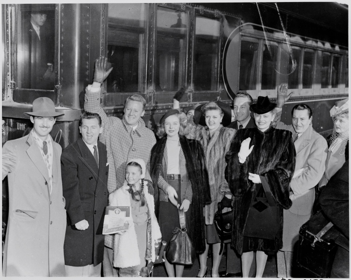Photograph_of_movie_stars_arriving_in_Washington_to_participate_in_Roosevelt_Birthday_Ball_activities,_(from_left_to..._-_NARA_-_199328