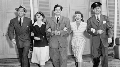 Preston Sturges flanked by cast of Palm Beach Story