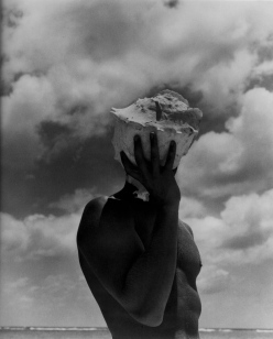 Man Holding Shell Photographed by Herb Ritts