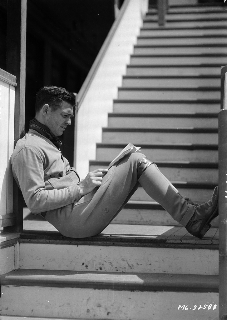 Clark Gable reads between setups | BEGUILING HOLLYWOOD