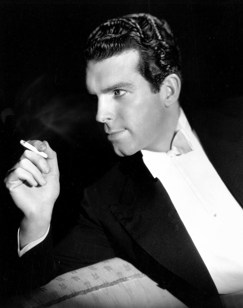 I m dudein up my shirt front puttin in the shirt studs for Fred macmurray