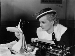 Actress Bette Davis Sitting at Typewriter During Scene