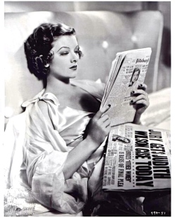 Myrna+Loy+reading+paper