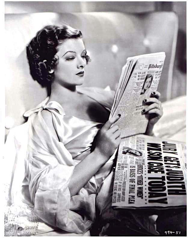 Myrna+Loy+reading+paper