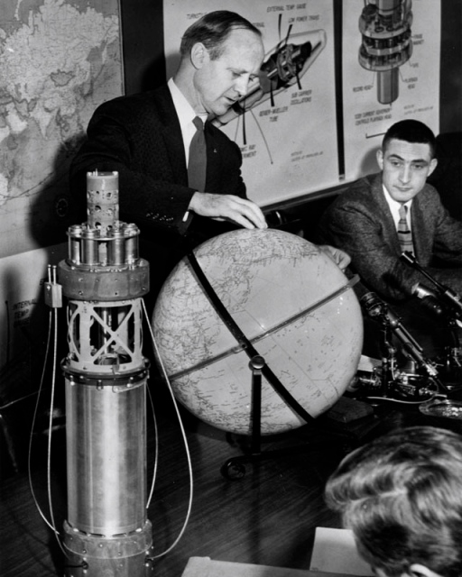 "March 5, 1958, ""Dr. William H. Pickering, left, director of Caltech's Jet Propulsion Laboratory, discusses America's second Satellite Explorer II at Pasadena headquarters. Model of interior of satellite is shown on desk."" On the right is Al Hibbs."