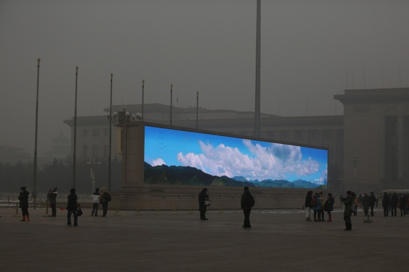 BEIJING, CHINA - JANUARY 23:  The LED screen shows the blue sky on the Tiananmen Square at dangerous levels of air pollution on January 23, 2013 in Beijing, China. The air quality in Beijing on Wednesday hit serious levels again, as smog blanketed the city.  (Photo by Feng Li/Getty Images)