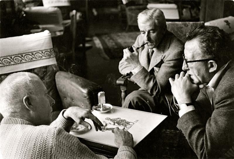 Robert Capa photo of: Howard Hawks, William Faulkner, and screenwriter Harry Kurnitz